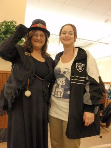"""At our annual Library Staff Association Holiday Party, the costume contest was """"Decades.""""  Here, colleague Julie Ree and I show off our 90's looks - 1890s and 1990s that is!"""